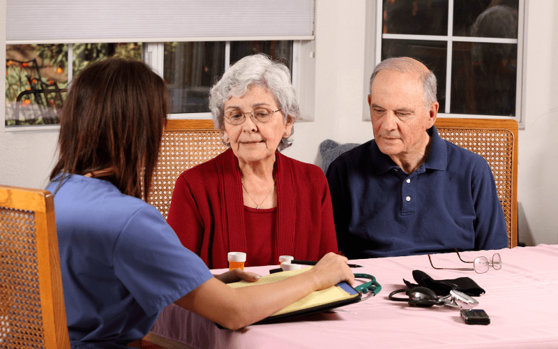 care-coordinator-discussing-options-with-elderly-couple