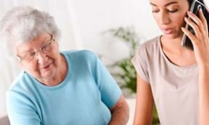 Home Care - An Elder And Young Person On The Phone