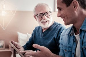 12 Signs Your Loved One Needs A Caregiver - Elderly Man and Young Man Talking
