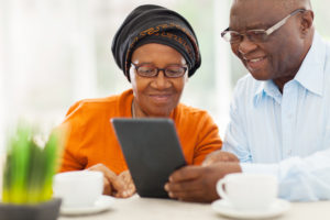Care Portal - Lovely Elderly African American Couple Using Tablet