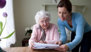 Home Care - A Caregiver With A Cute Old Lady