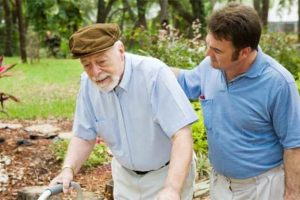 MCG Gives Back - Home Care Aid Walking With Elderly Man