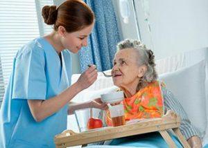 Certified Nursing Assistant - CNA Feeding Elderly Patient