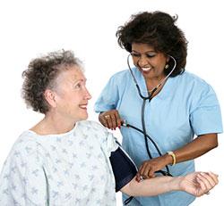 Certified Nursing Assistant - CNA Testing Vitals On Elderly Patient
