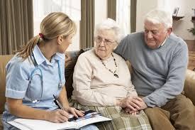 Caregiver - Caregiver Talking to Elderly Couple