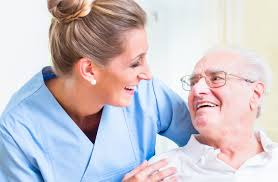 Caregiver - A Nurse Laughing With An Elderly Man
