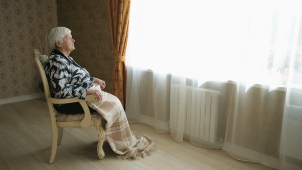Senior Social Isolation - Elderly Woman Alone In A Chair