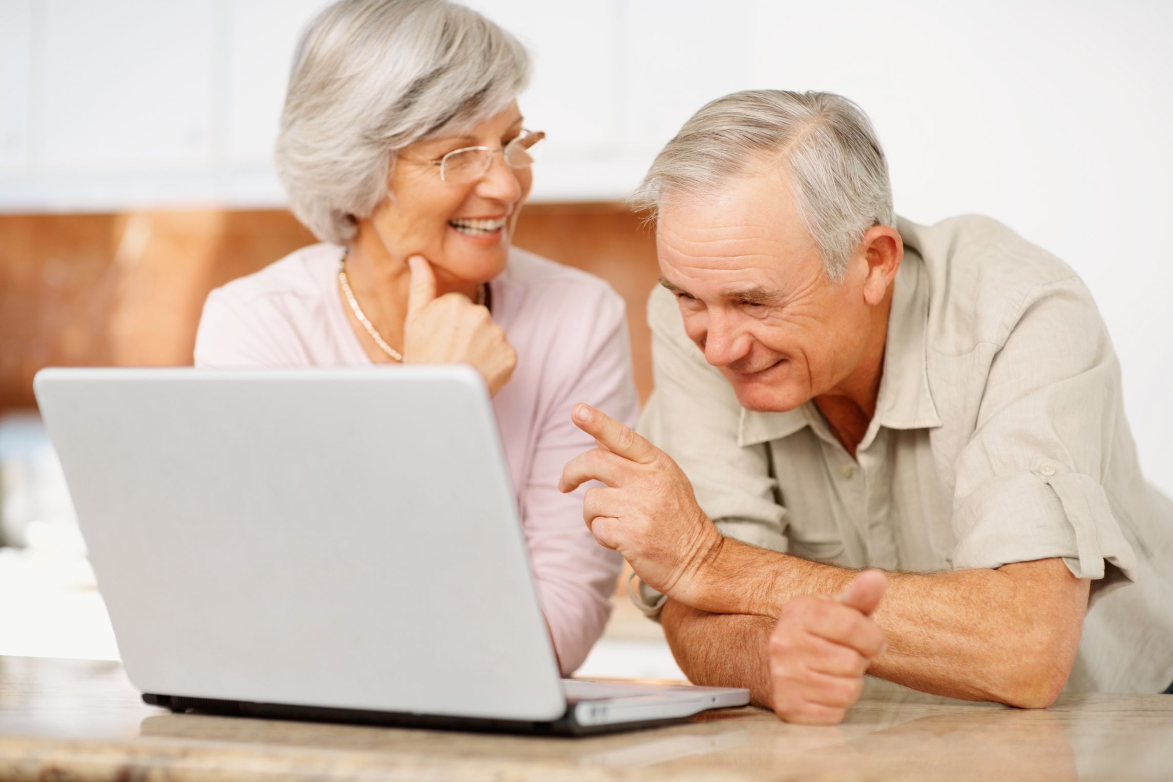Technology for Seniors - Older Couple On A Laptop