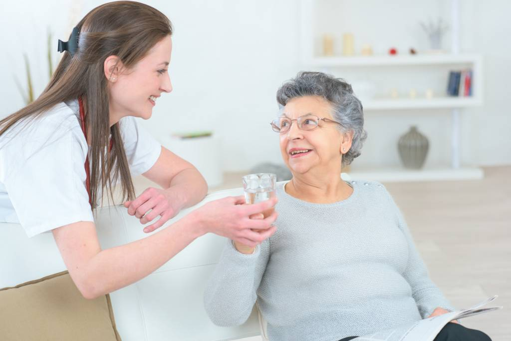 Respite Care - Caregiver Holding Elderly Woman's Hand