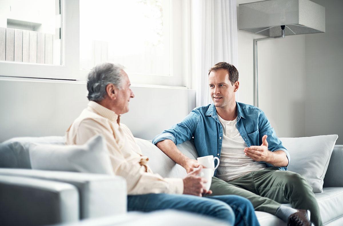 Respite Care - Middled Aged Son Talking To Senior Parent