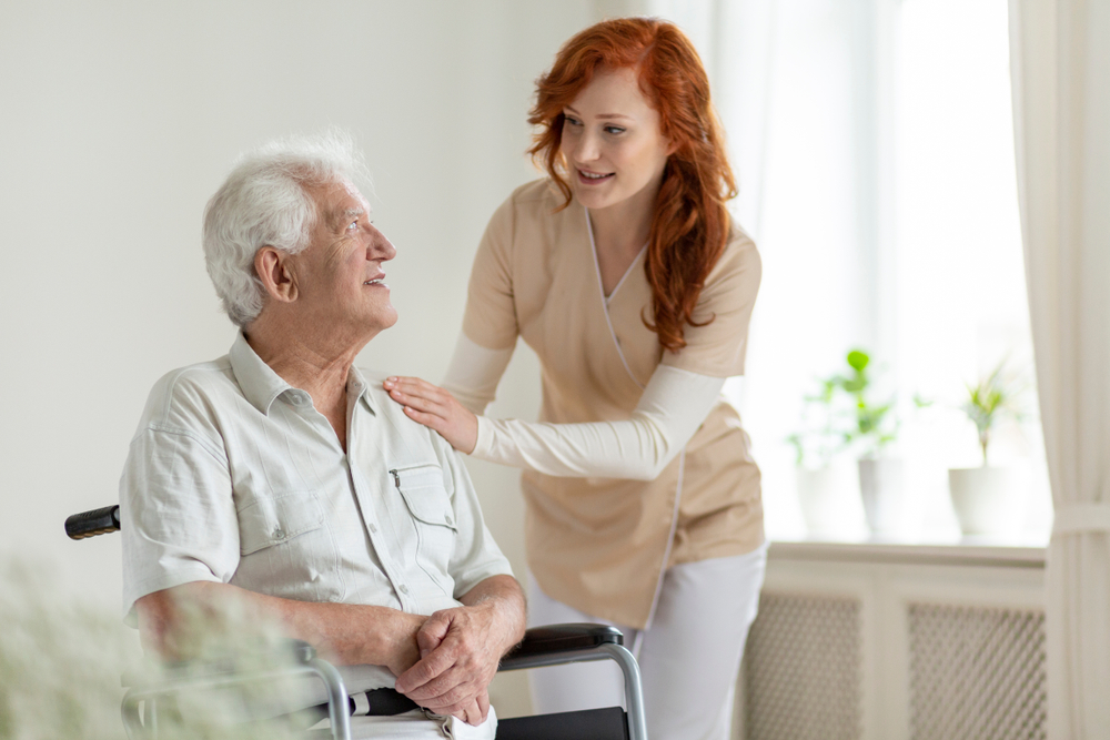 Respite Care - Young Woman With An Elderly Man