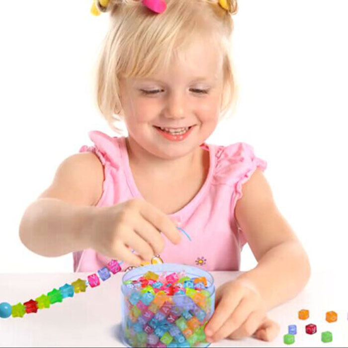 Summer Activities To Do With The Grandkids - A Child Making Bead Jewelry