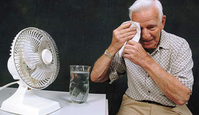 Heat And High Blood Pressure Medication - Elderly Man Cooling Down