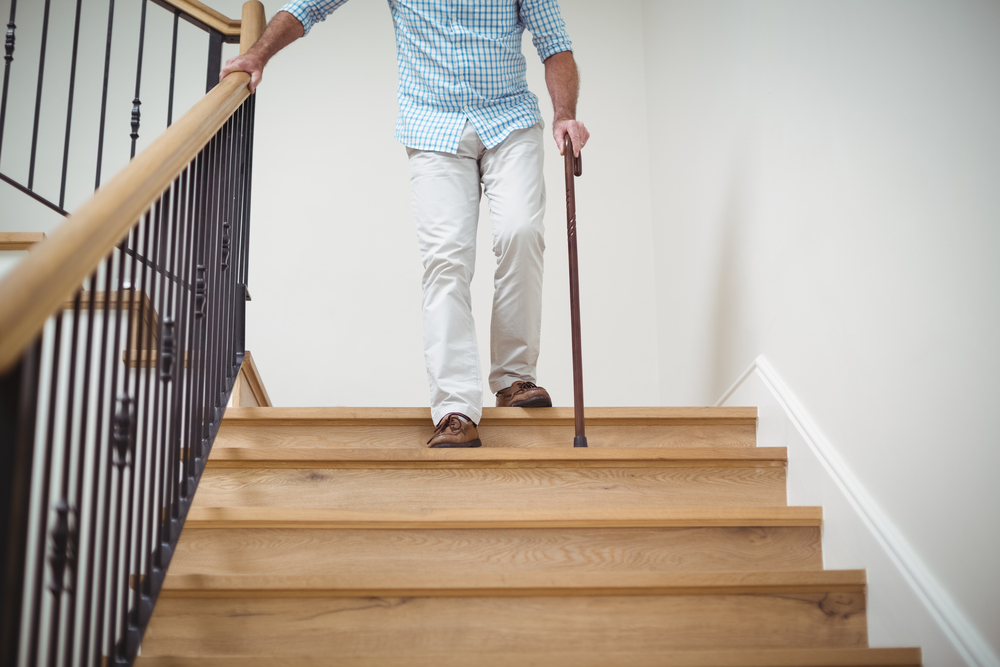 Summer Safety for Seniors - Elderly Man Walking Downstairs With A Cane