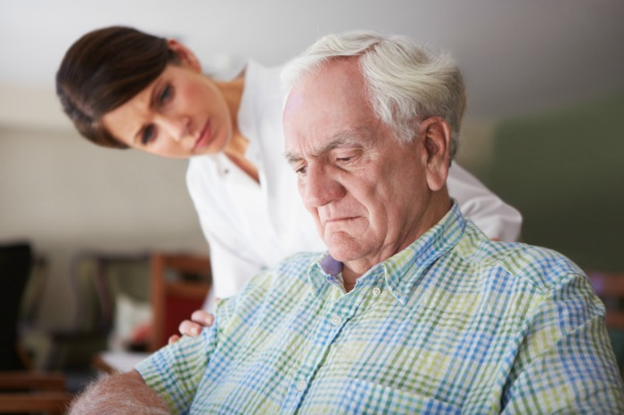 Depression In The Elderly - Concerned Woman Looking At Older Man