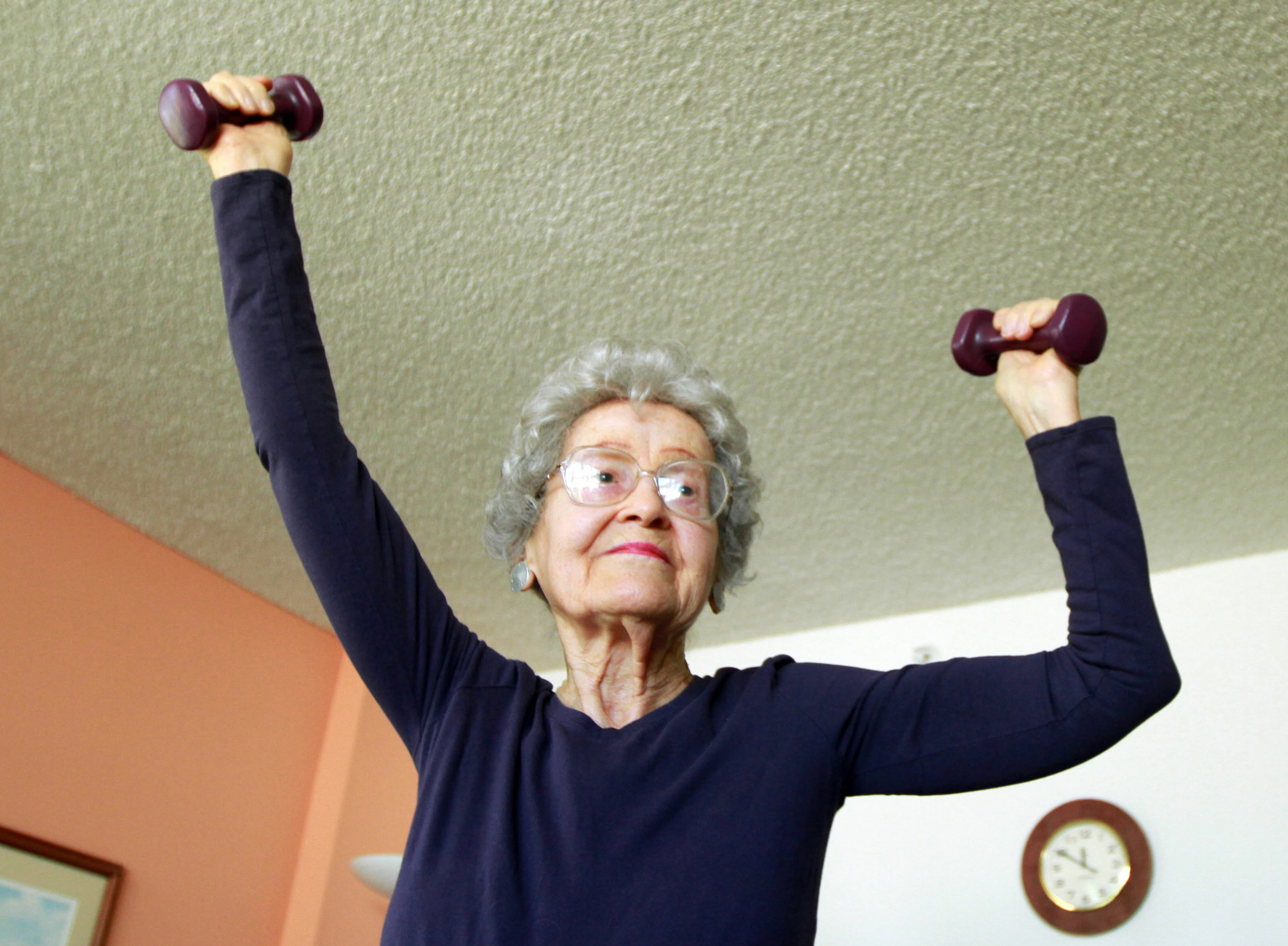 Depression In The Elderly - An Elderly Woman Lifting Weights