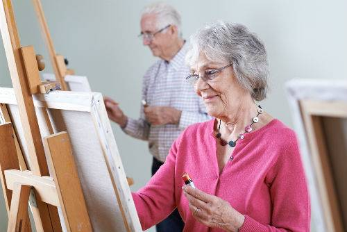 Depression In The Elderly - Elderly Woman Painting In Class