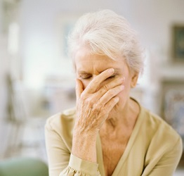 Depression In The Elderly - Older Woman Covering Her Face
