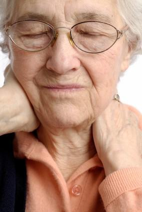 Pain Awareness Month - Closeup Of Elderly Woman Holding Her Neck