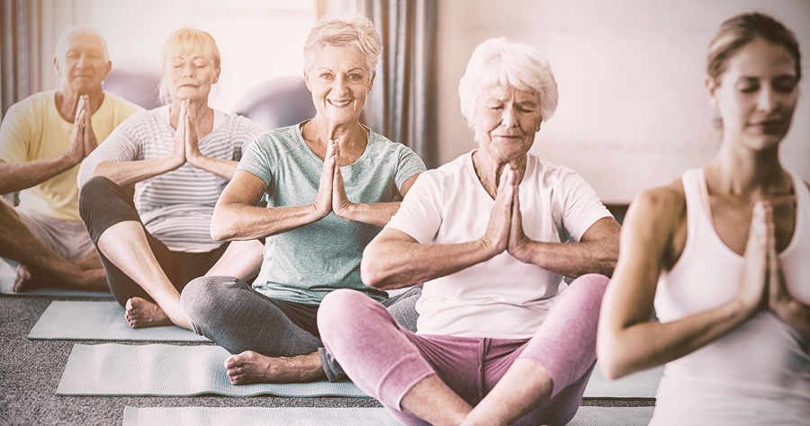 Pain Awareness Month - Older Adults Doing Yoga
