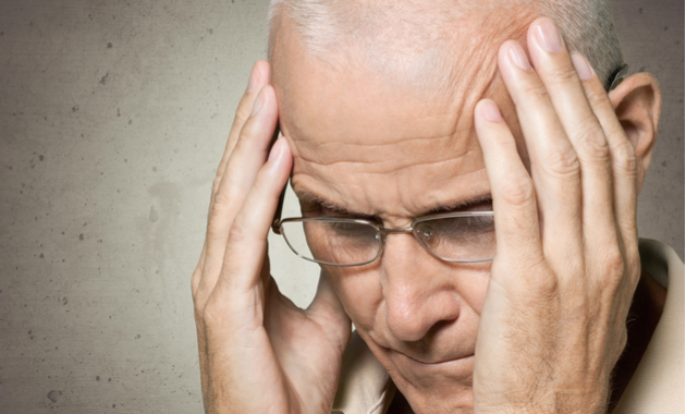Stroke Warning Signs - An Older Man Rubbing His Temples