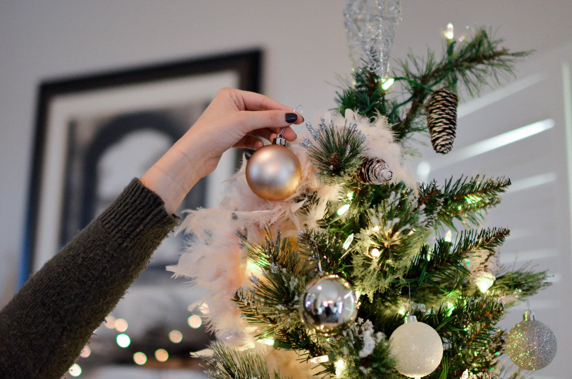 Senior Safety - A Woman's Hand Placing An Ornament On A Tree
