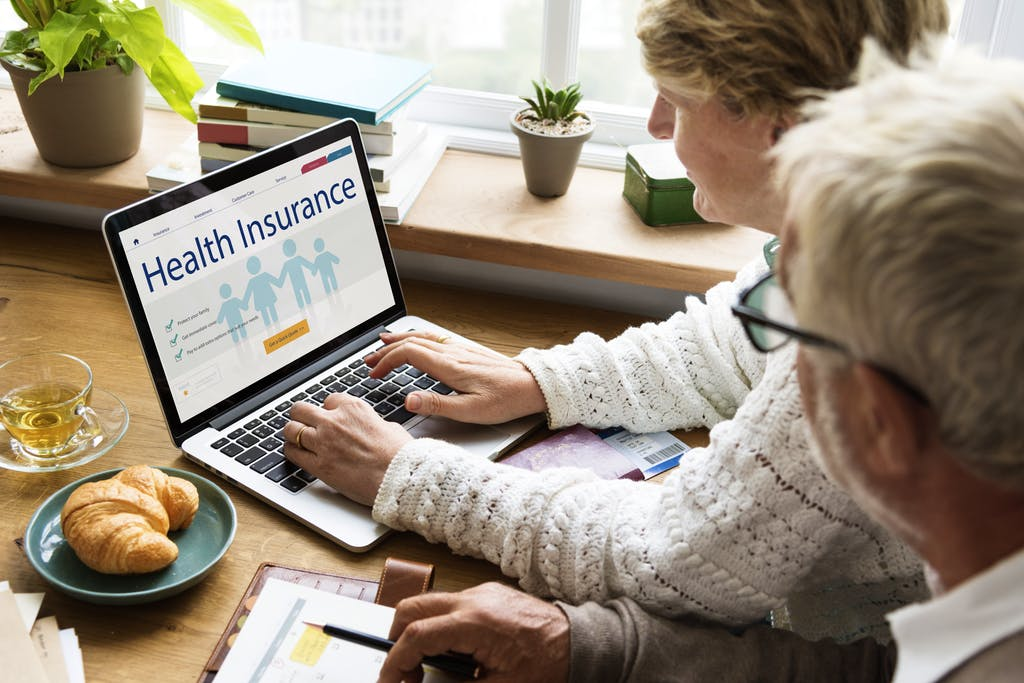 Senior Health Care - A Senior Couple Picking Insurance Plance