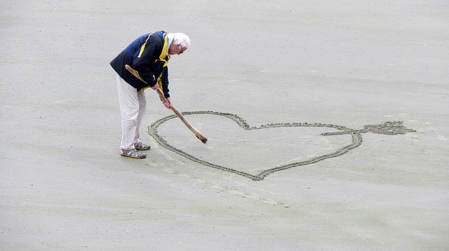 Senior Dating - Old Man Drawing A Heart In The Sand