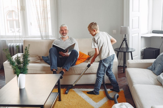 spring-cleaning-photo-of-boy-cleaning-the-carpet-3890169