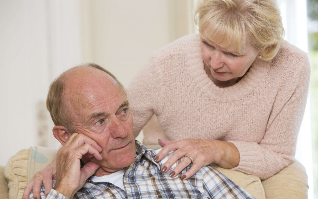 stress-awareness-month-a-stressed-older-man-being-comforted-by-his-wife
