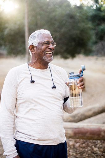 A-senior-African-American-Man-enjoying-refreshing-water-after-a-workout