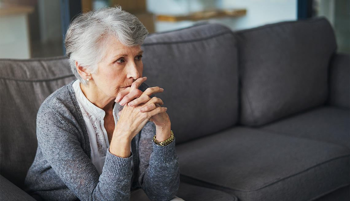 mental-health-month-pensive-senior-woman-sitting-on-the-couch