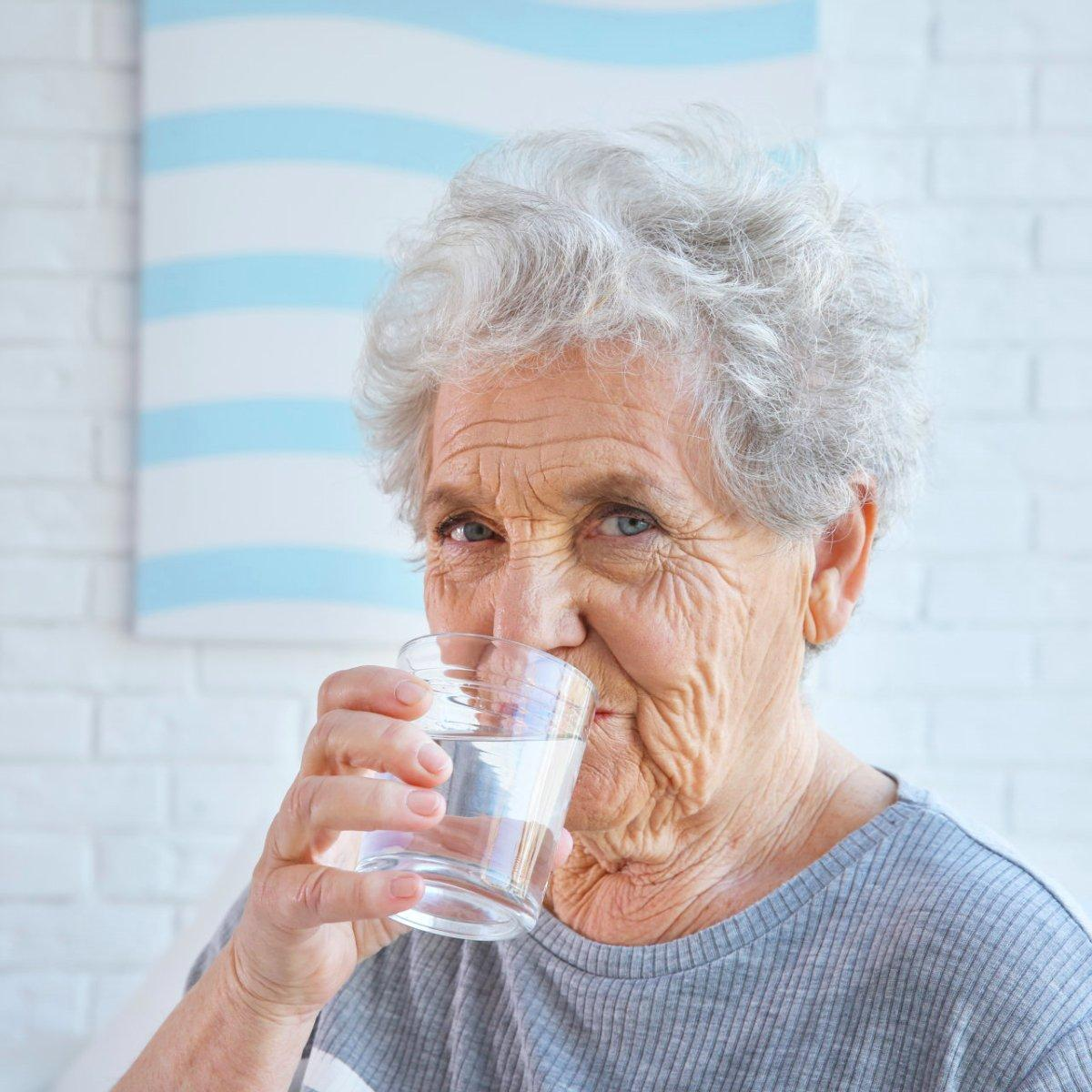 skincare-for-seniors-elderly-woman-drinking-water