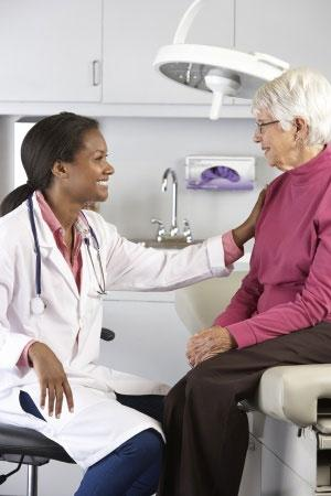 Health Literacy - Senior Woman Discussing Health With Doctor