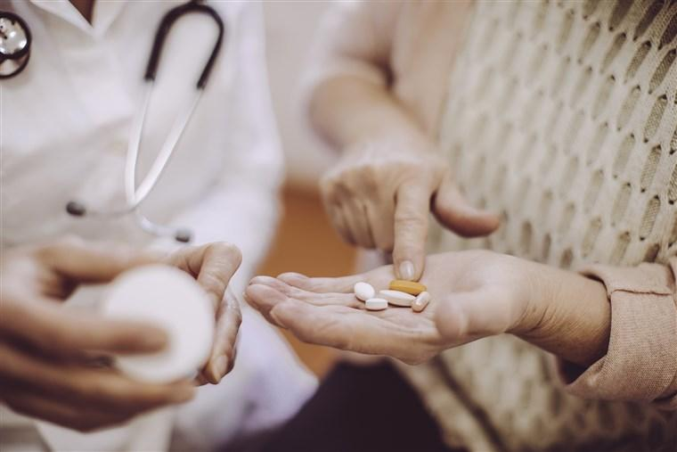 Heat And High Blood Pressure Medication - People Holding Pills