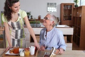 Caregiver - Qualified Caregiver Helping A Nice Lady