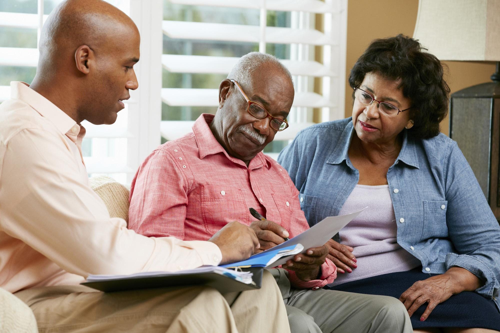 mental-health-month-a-senior-couple-talking-over-their-options-with-a-financial-advisor-at-home