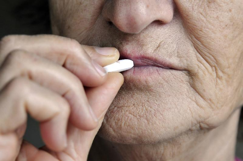 Sleep For Seniors - Elderly Person Taking A Pill