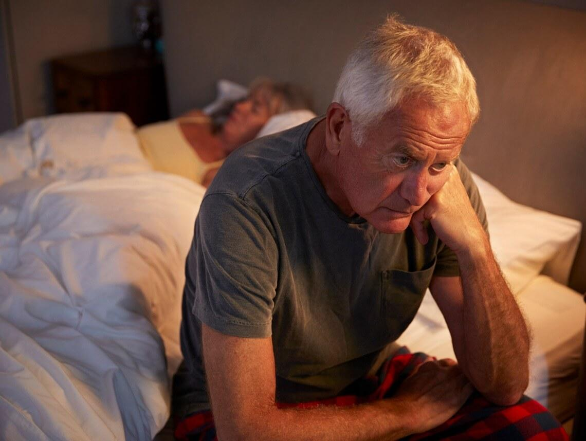 Sleep For Seniors - Senior Man Sitting On Edge Of Bed