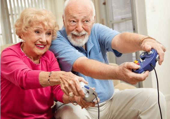 Technology For Seniors - Older Couple Playing Video Games