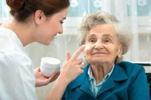 Caregiver - Nurse Applying Cream