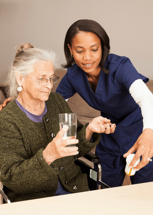 caregiver-types-nurse-helping-elderly-woman-with-medication