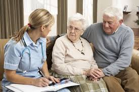 Caregiver - Caregiver Talking to Elderly Couple
