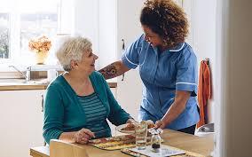Home Care - A Nurse Talking To A Senior
