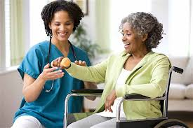 Home Care - Nurse Assisting Elderly Woman
