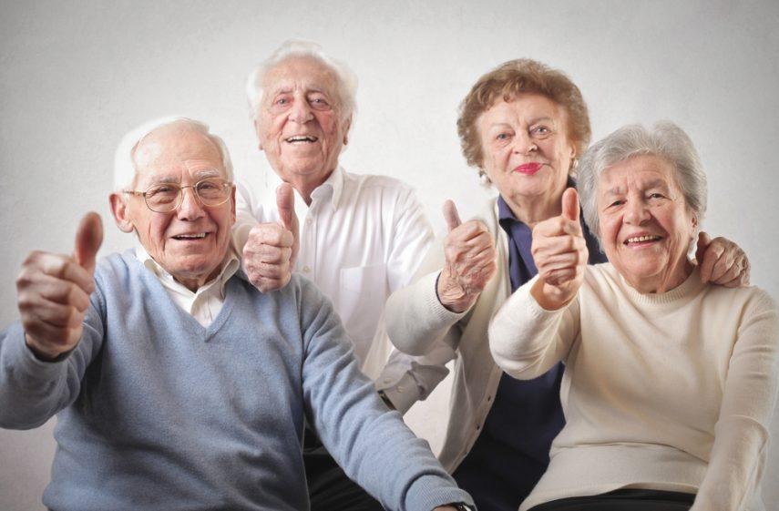 counseling-awareness-month-a-group-of-four-seniors-smiling-and-giving-the-thumbs-up