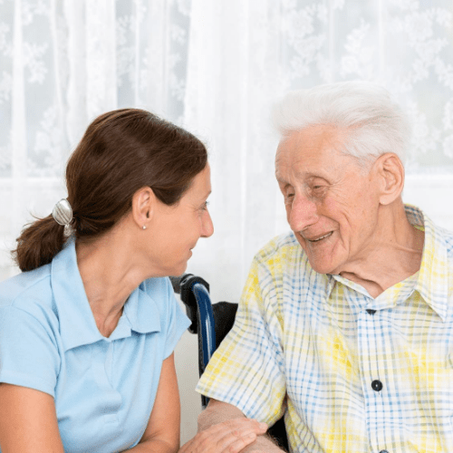 caregiving-responsibilities-woman-chatting-with-elderly-man