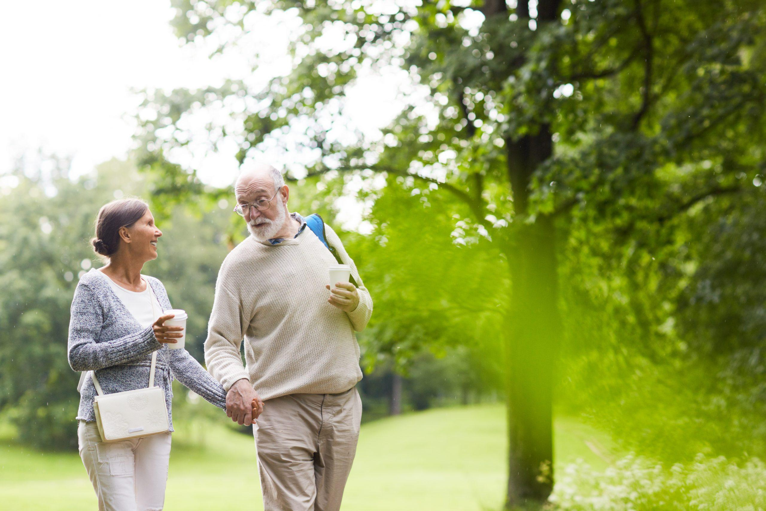 senior-couple-observing-healthy-aging-month-by-going-on-a-walk