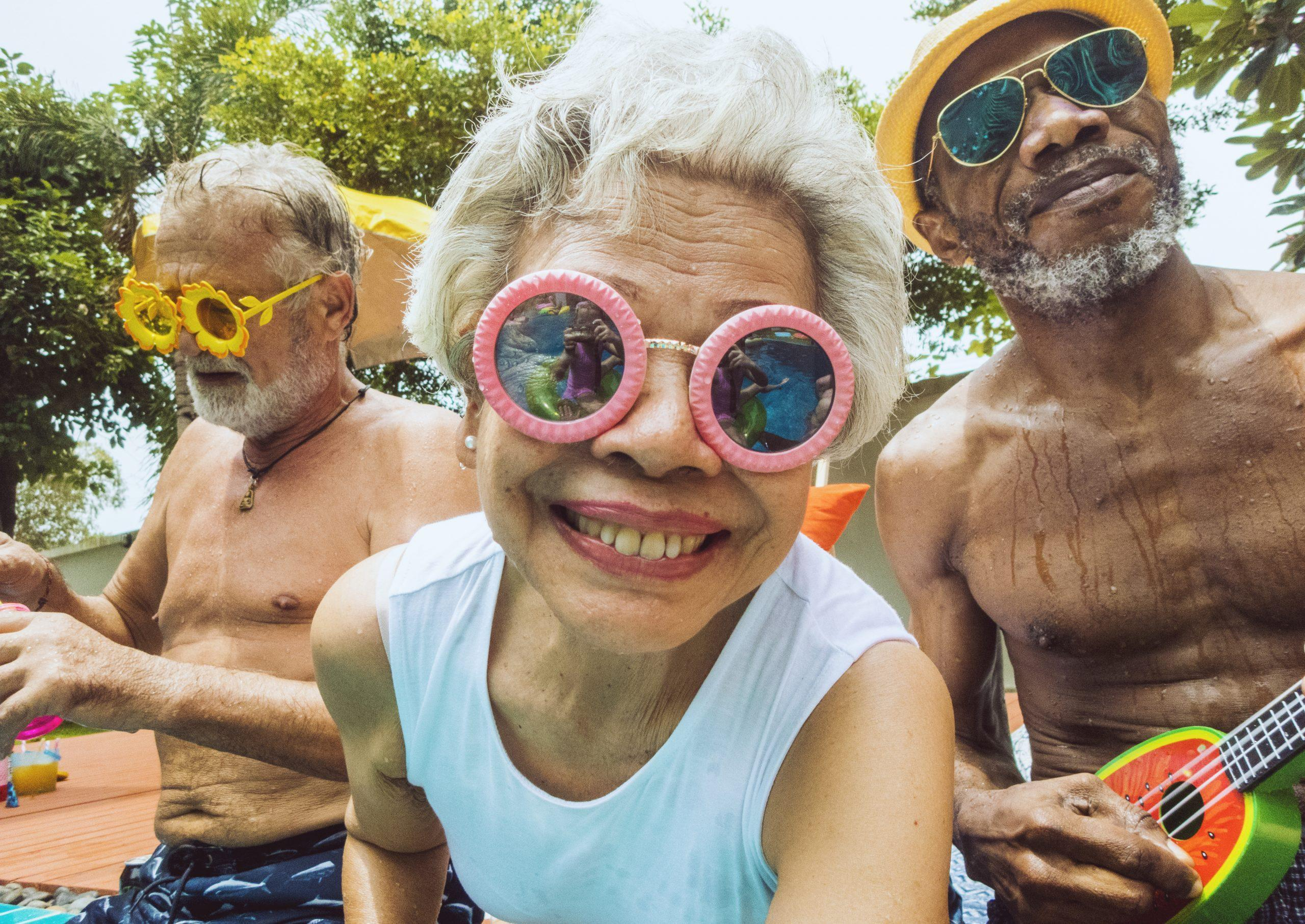 Closeup-of-diverse-senior-adults-sitting-by-the-pool-enjoying-summer-together
