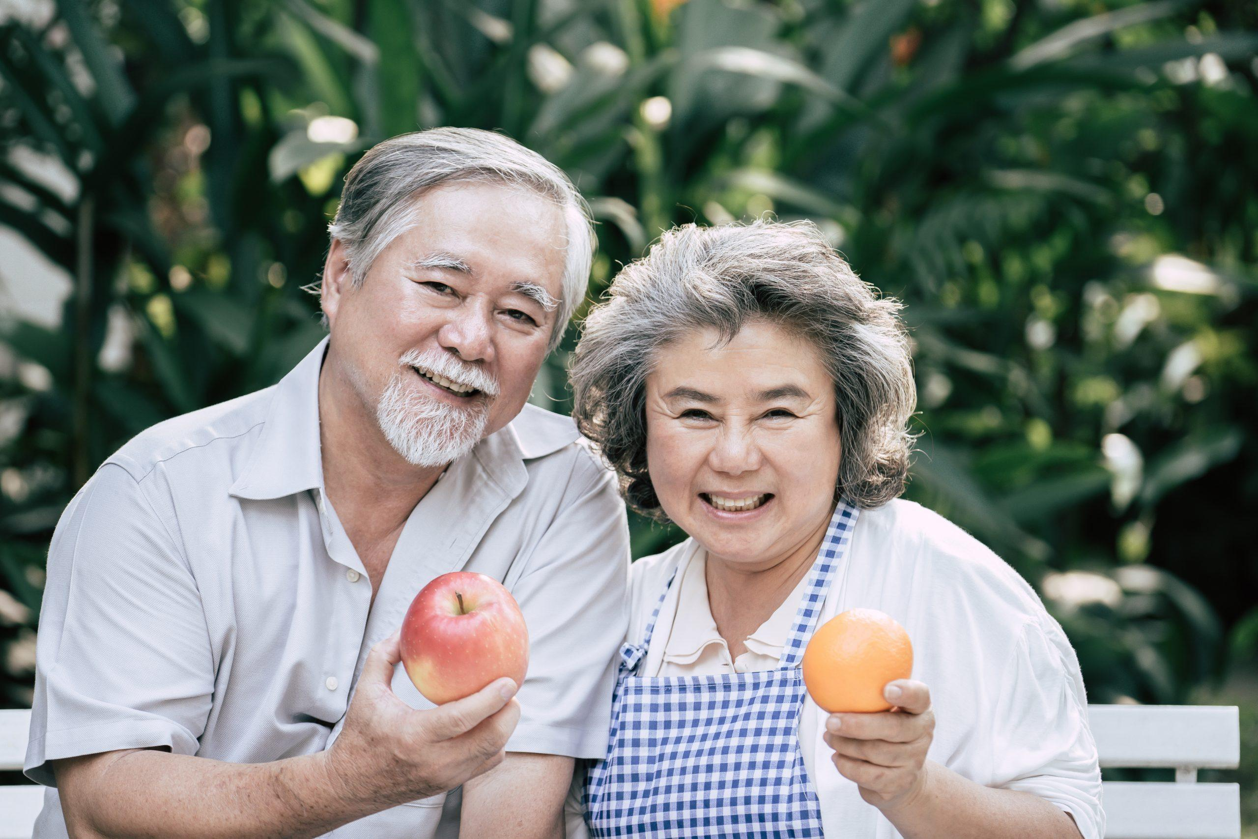 elderly-couple-celebrating-healthy-aging-month-by-choosing-nutritious-foods